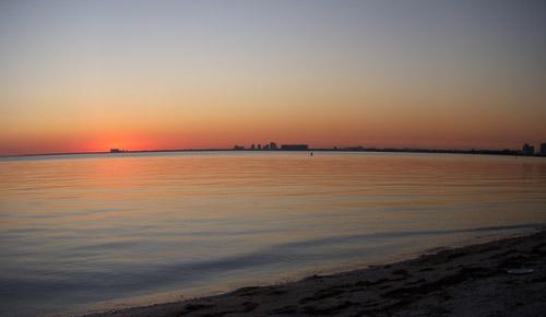 curved beach sunset