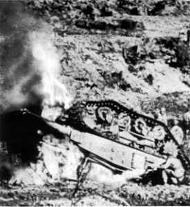 This is a M4 Sherman Tank after striking an aircraft bomb land mine in front of Kakuza Ridge