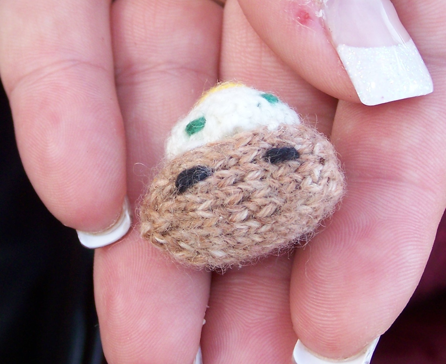 Knitted tiny baked potato