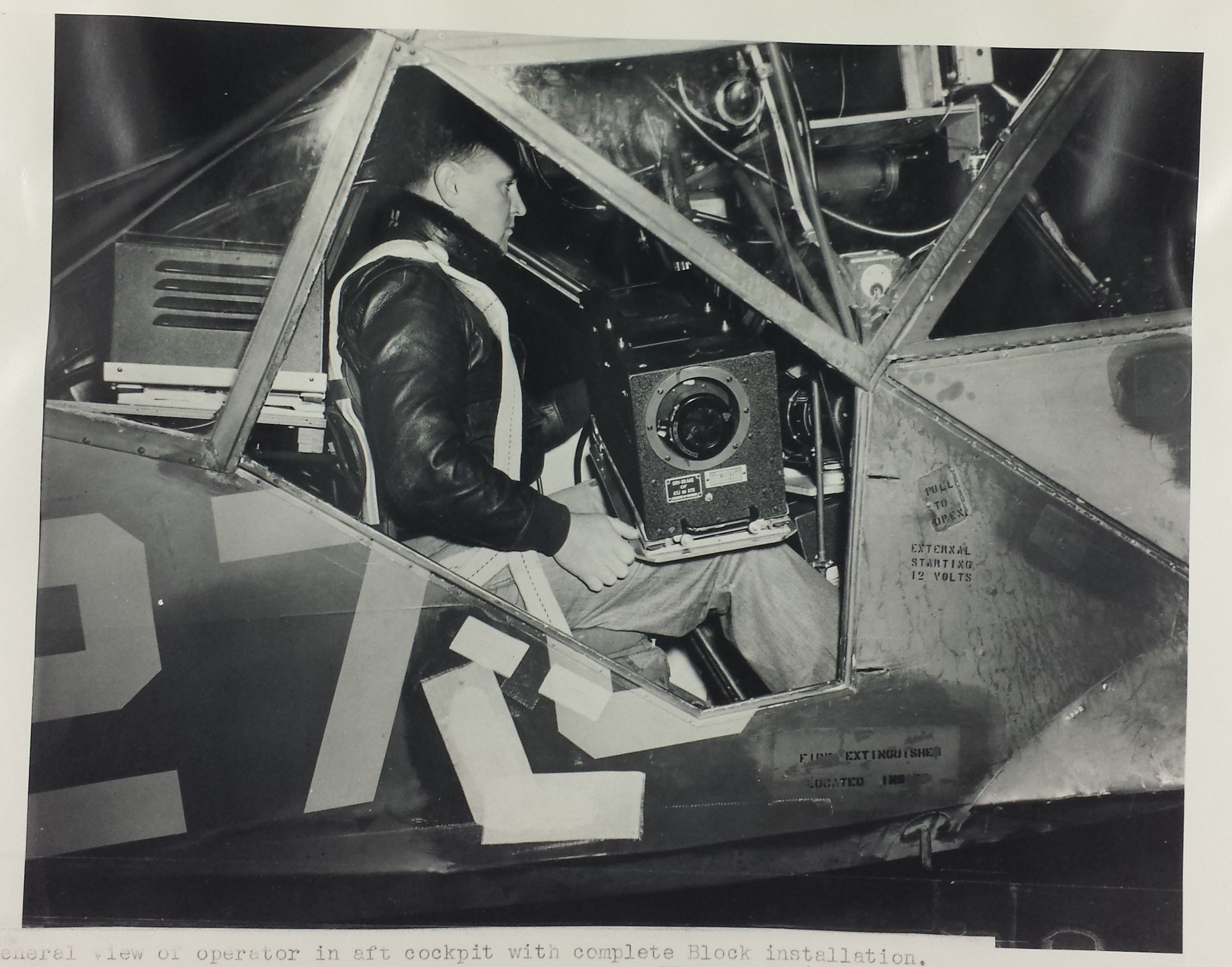 "This is a photograph of the installation of block III TV Camera in the Stinson L-5 Sentinel. This aircraft  was a World War II era liaison aircraft used by all branches of the U.S. military and by the British Royal Air Force.  It was slated to play the role of a ""Manned UAV"" providing live television of the invasion of Japan"