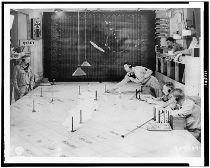 Members of the Signal Corps using radar plotting board as an aircraft warning information center at 1st Island Command Headquarters, Noumea, New Caledonia -- <em>Original Signal Corps Caption  </em>