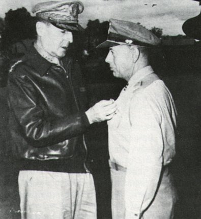 General Douglas MacArthur decorates General George Kenney