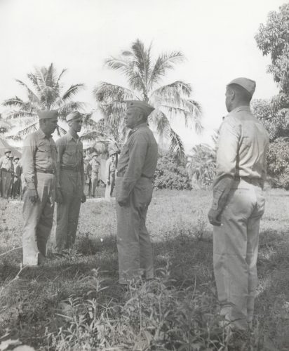 Major Gen. Roy Geiger (Center) awarding Navy Cross to Col Cooley (far Left) and Silver Star to MTSgt Dermott H. MacDonnell (2nd from the Left)