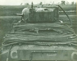 Rolled flame hose on rear deck of POA-CWS-H1 Flame Tank