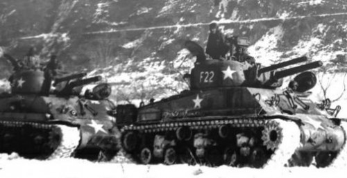 Two Korean War vintage M4A3E8 Sherman tanks, with coaxial POA-CWS-H5 flamethrower and 105mm gun.  There would have been 56 such tanks arming the three USMC (12 ea for a total of 36) tank battalions) and  two US Army ( 10 ea. for a total of 20) tank battalions.